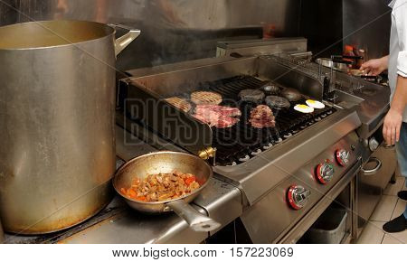 Real kitchen of bar and grill restaurant in operation