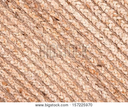 Jute pile hand woven beige area rug like artistic background