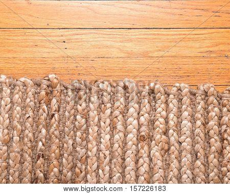 Jute pile hand woven beige area rug on old hardwood floor
