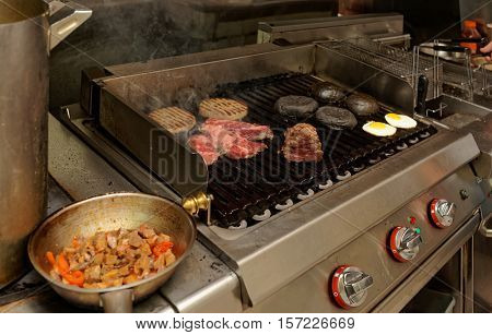 Real kitchen of a bar and grill restaurant in operation