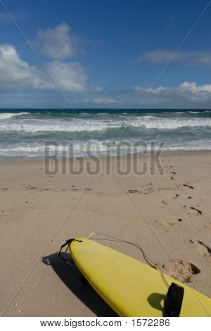Surfboard In The Sand