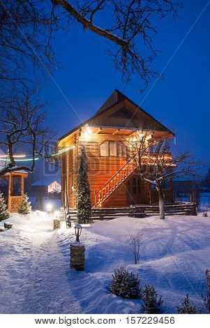 Small fairy-tale comfy house in winter snowy mountains near Bukovel famous ski resort Carpathians Ukraine