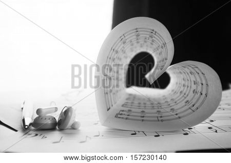 a sheet of white paper with printed thereon music notes on a table