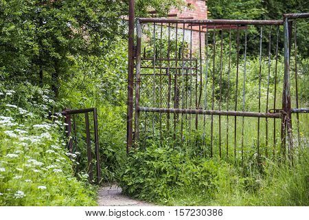 old-fashioned rusty turnstile to the abandoned area