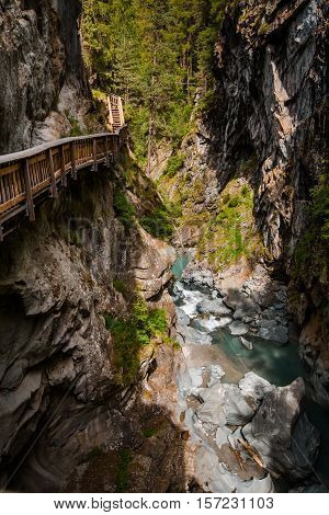 Vertical Shot Of Path In Gorner Gorge With River