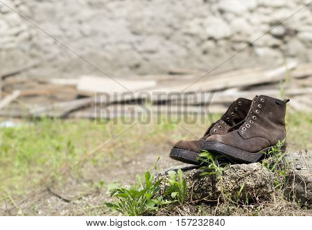 Old Leather Boots on Rock Without Shoestring