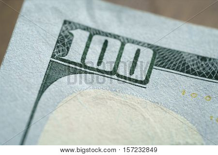 macro photo of hundred dollar bill, very shallow focus