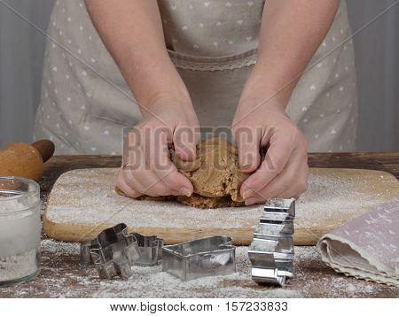 Women's hands making christmas cookies. Tradicional xmas dessert