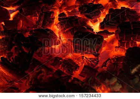 Glowing embers in hot red color. Embers closeup. Embers after a fire.