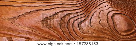 Old rich broun wood grain texture background with knots