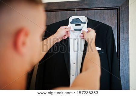 Man wearing shirt and jacket. Groom morning at wedding day.