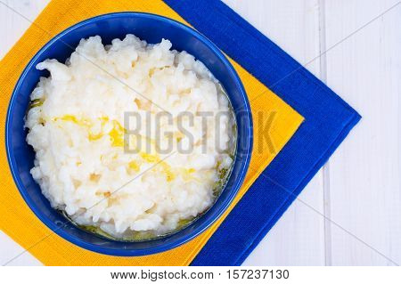 Rice pudding in a blue bowl. Studio Photo