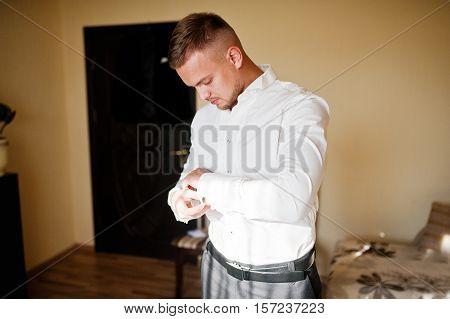 Man Wearing Luxury Cufflinks  On Shirt. Gathering Of Groom On Wedding Day.