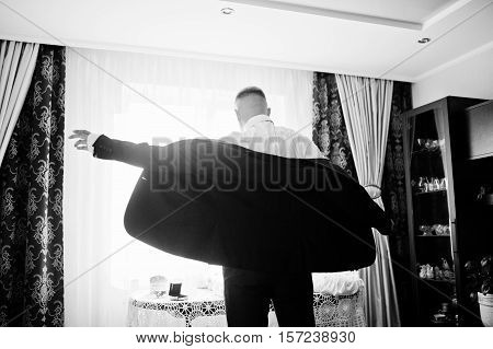 Man Wearing Luxury Jacket Background Backlight Of Window. Gathering Of Groom On Wedding Day. Black A
