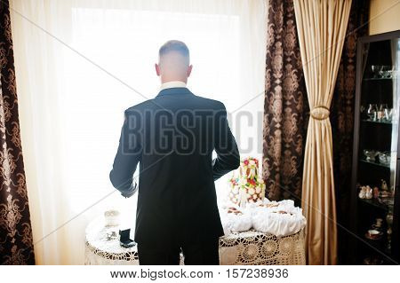 Man Wearing Luxury Jacket Background Backlight Of Window. Gathering Of Groom On Wedding Day.