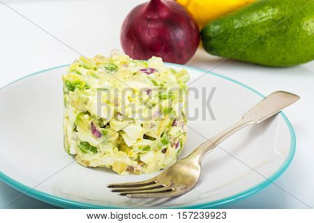 Salad with Avocado, Boiled Eggs, Red Onion and Mayonnaise. Studio Photo