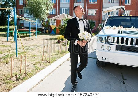 Handsome Groom Out Into Limousine And Looking For His Bride.
