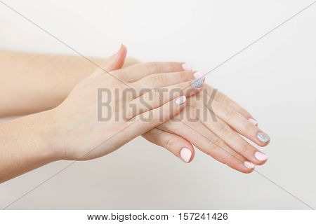 Woman Taking Care Of Her Dry Hands Applying Cream.