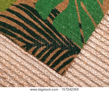 Waterguard indoor and outdoor decorative entrance mat on jute pile area rug