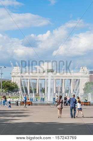 Moscow - JUNE 18, 2012: Light and music fountain and the Main entrance to Gorky Park