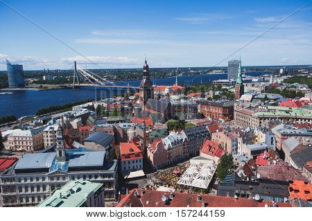 Beautiful super wide-angle panoramic aerial view of Riga, Latvia with harbor and skyline with scenery beyond the city, seen from the St. Peters Church observation tower,sunny summer day with blue sky poster