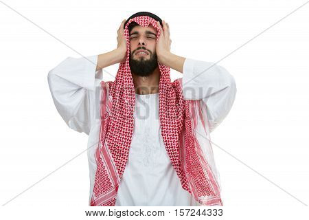 Young disappointed Arab with a checkered veiland holding his head.