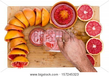 Man Pouring Freshly Squeezed Ruby Grapefruit Juice
