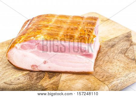 Meat product-smoked bacon on Wood Background. Studio Photo