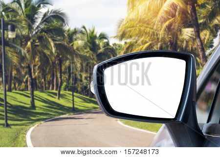 side rear-view mirror on a car in the park.