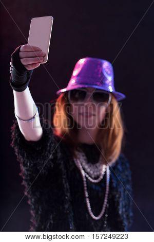 Woman Dressed As A Popstar Taking A Selfie