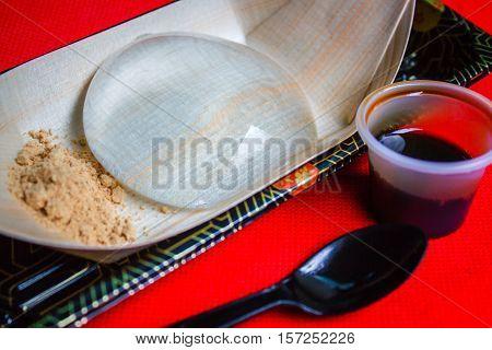 "Water cake (the water drop dessert mochi ""mizu shingen mochi"" or ""Yamanashi Mochi "") Japanese style dessert with decoration Raindrop Mizu Mochi. poster"