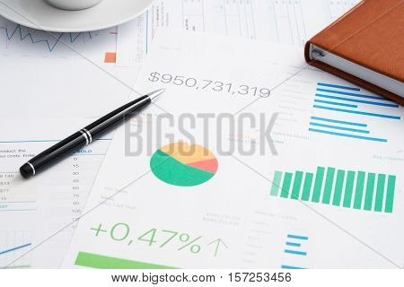 Business analytic paper and pen financial concept