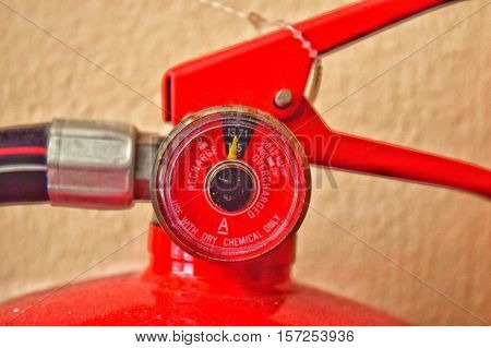 A speedometer with red needle pointing to Fired Up, encouraging people to get motivated