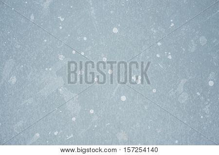 White splash on gray background concrete wall messy splotchy surface