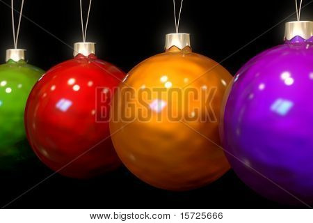 Close-up of multi colored Christmas baubles in a row