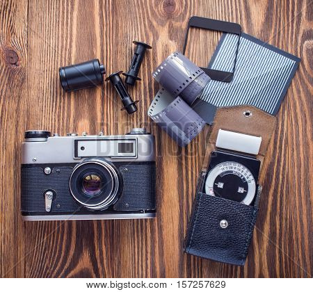 old soviet rangefinder camera, exposure meter and another trappings of film photography