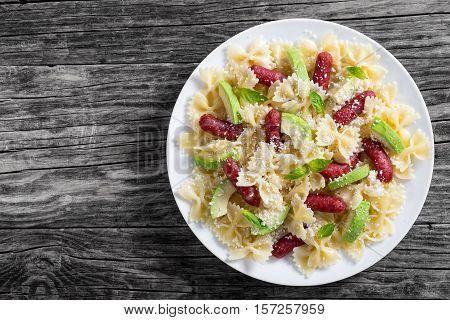 Mini Salami Bowtie Pasta Warm Salad Sprinkled With Grated Parmesan