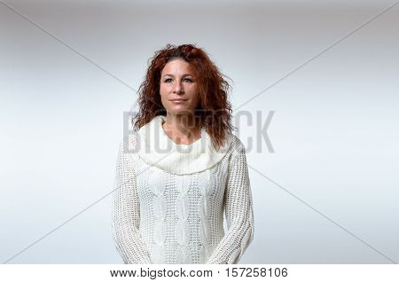 Gorgeous Woman In Sweater Over Gray Background