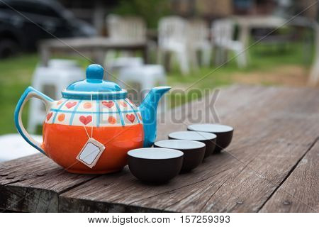 close up of the tea cups and tea pot