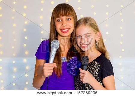 Pair Of Girls Singing On Karaoke