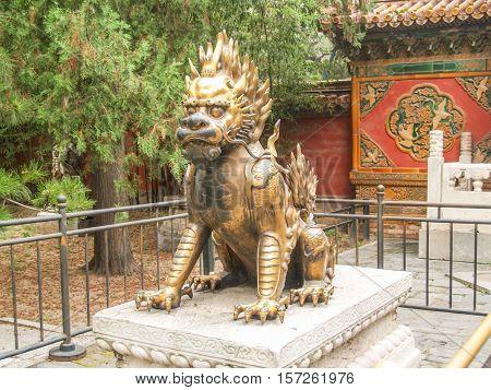 Bronze lion guarding entrance to a garden of Beijing Forbidden city