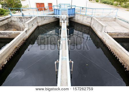 Modern urban wastewater treatment plant. Water cleaning facility outdoors. Water purification is the process of removing undesirable chemicals suspended solids and gases from contaminated water. poster