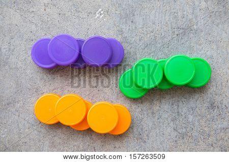 plastic bottle screw caps used to seal plastic bottles green orange and violet