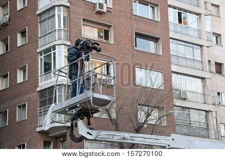 Cameraman working on an aerial work platform