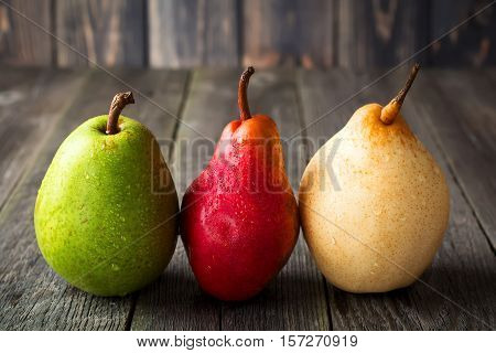 Red green yellow sweet pears on a dark background. Selective fokus.Rustik style.