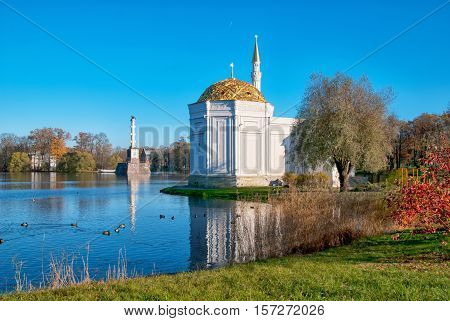 TSARSKOYE SELO, SAINT - PETERSBURG, RUSSIA - OCTOBER 19, 2016: Autumn view of The Turkish Bath Pavilion on the bank of the Great Pond in the Catherine Park. Left side is Chesme Column