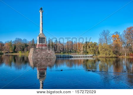 TSARSKOYE SELO, SAINT - PETERSBURG, RUSSIA - OCTOBER 19, 2016: Autumn view of The Chesme Column on the Great Pond in the Catherine Park. The Tsarskoye Selo is State Museum-Preserve.