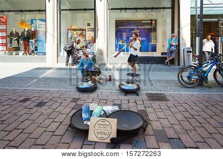 Potsdam Germany August 27 2016: Musician playing on a street in Potsdam for some people summer time