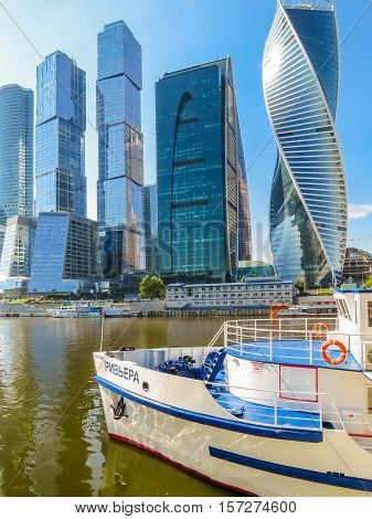 MOSCOW, RUSSIA - JULY 17, 2016: Moscow skyline. Modern skyscrapers in business district and river ships on the Moscow River
