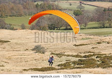 Paraglider landing in the Brecon Beacons, Wales